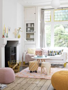 Pretty styling in this light, bright living room. Loving how the colour palette has been inspired by the stained glass!