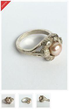Flor de Perla. Anillo de plata 950 con una flor, modelado en cera perdida, vaciado, pulido y montado con una perla rosa.