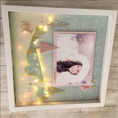 Create a fun Sugar Plum light up shadow box using four sheets of scrapbook paper, firefly lights and a shadow box. Lights up the house for the holidays!