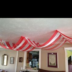 Big top streamers for a circus theme ceiling.