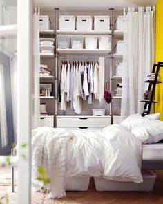 Create an Instant Closet If you don't have a closet, take the end of a room and section it off with curtains, add shelves and dividers and you have an instant closet.