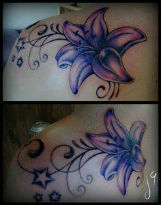 ..shoulder blade flower tat..
