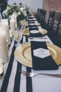 black, white, and gold table setting