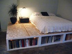 Raise up your bed to create a ton of storage and bookshelves underne...