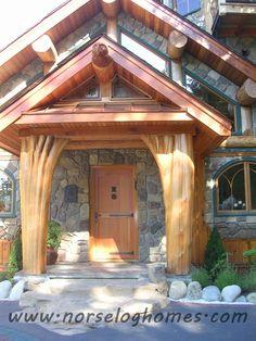 Super unique upside down Cedar entrance posts!