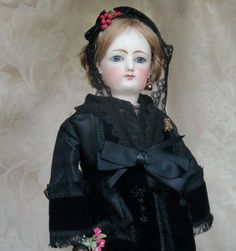 This beauty looks like she just walked out of the 1800's with her gorgeous black silk and velvet dress with her lace coronet and sweet little half