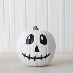 Combine two Halloween icons in one craft with this skeleton painted pumpkin with paint from #marthastewartcrafts