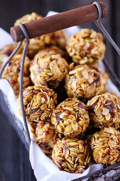 1 cup (dry) oatmeal 2/3 cup toasted coconut flakes   1/2 cup peanut butter   1/2 cup ground flaxseed or wheat germ   1/2 cup chocolate chips (optional)   1/3 cup honey or maple syrup   1 tsp. vanilla extract    Stir all ingredients together. Let chill in the refrigerator for half an hour. Once chilled, roll into balls. Store in an airtight container and keep refrigerated