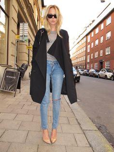 Black coat, grey t-shirt, nude heels, black sunglasses, distressed jeans.