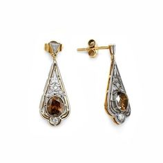 gold earrings  with diamonds. Mixture of white and yellow gold perectly matches with the brown diamonds.   #diamond #gold #diament #brylant #zloto