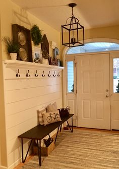 Shiplap entryway with hooks and bench!