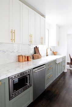 kitchen renovation // smitten studio. Absolute perfection! Love the color of the cabinets, the brass pulls, and marble countertops and backsplash.
