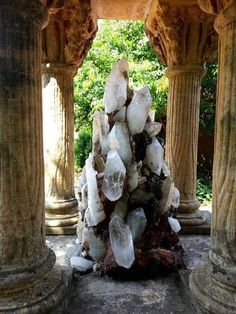 Magnificent quartz crystal cluster placed in the center of grand old stone columns. From the Chicago Botanic Garden.  Address:1000 Lake Cook Rd, Glencoe, IL 60022, United States   Geology Wonders