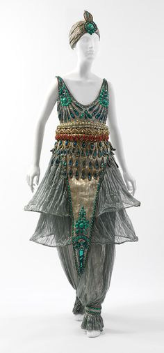 """Poiret's """"The Thousand and Second Night"""" (1911) party revolved around a fantastic evocation of the East. For the occasion, Poiret required his 300 guests to dress in oriental costumes. Those who failed to do so were given the choice of leaving or outfitting themselves in Persian-style clothes designed by the couturier, including the highly controversial """"harem"""" trousers that formed part of his spring 1911 collection.  Now THAT is a party."""