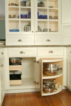 what a smart corner cabinet  design  easy to reach.. must remember this