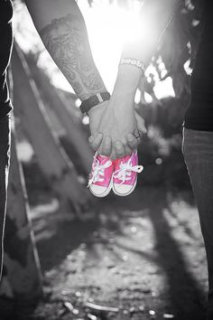 Maternity picture holding hands with baby shoes click for website has tons & tons of ideas for maternity, newborns, family, etc.   Pictures by http://www.technicadesigns.com/