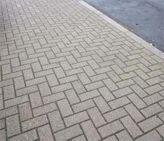 Image from http://www.diydoctor.org.uk/project_images/driveway-ideas-and-suggestions/herringbone-brick-paved-drive.jpg.