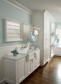 Love the color of the wall and the big cabinet.  Also the 2 hanging racks over the sink.