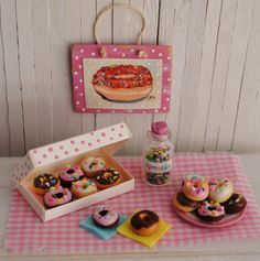 Miniature Donuts With Sprinkles In a Cute Polka Dot Box, A Plate Of Donuts, A Jar of Sprinkles, And A Donut Wall Hanging. $21,50, via Etsy.