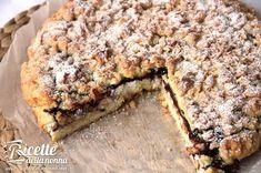 La torta o crostata sbriciolataè ormai un classico dei dolci italiani. Fondamentalmente è una variante della classica crostata e in questa ricetta è realizzata con ricotta e Nutella. Procedimento Iniziate con l'amalgamareil burro ammorbidito con la farina, il lievitoe lo zucchero. Quindi unite le uova.Quando l'impasto sarà liscio e omogeneo, prendetene 2/3 e, sbriciolandolo con […]