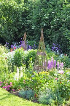 Obelisks in a cottage garden.