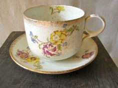 Grandiose Warranted Ironstone-  Overtly Grandiose Coffee Mug & Saucer. Display it or put coffee, keys, flowers or cotton balls in it.  Crackled Goodness.  Stamped Ironstone  Mug: 5.5″ dia. x. 4.75″h  Saucer: 8.5″ dia  $24.00