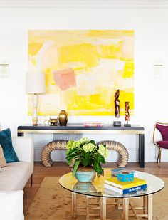 Love the statement of one HUGE piece of artwork vs. lots of little pieces. Go big!