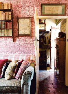 Welsh cottage. Oh my. That pink wallpaper. Just lovely. For kids bedroom perhaps? And all the pillows and books!!! <3