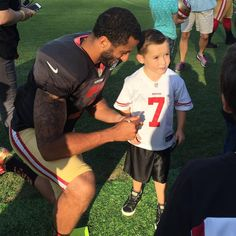 """""""#49ers @Kaepernick7 meets with one of @Camp_Taylor kids who attended practice"""""""