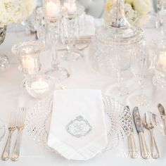 Beautiful all white wedding table setting