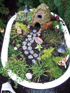 Fairy garden in an old bathtub