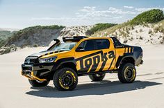 The Toyota HiLux Tonka is built for off-road adventuring thanks to a lifted suspension, oversized off-road tires, and a liter turbo diesel engine. Suv Trucks, Toyota Trucks, Cool Trucks, Pickup Trucks, Cool Cars, Toyota Hilux, Toyota Tacoma, Land Cruiser 80, Toyota Land Cruiser