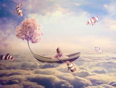 boating above the clouds, fish in clouds, pink flower tree part of boat, Photo Manipulations by PureRomance