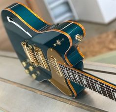 *Here is a limited edition, sparkle bound Daylighter Super Supreme in Ocean Turquoise. The Super Supreme Guitar Kits, Guitar Shop, Music Guitar, Cool Guitar, Acoustic Guitar, Ukulele, Beginner Electric Guitar, Electric Guitar And Amp, Cool Electric Guitars