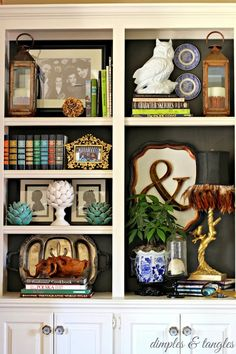 Bookcase styling, Ivory bookcase with dark background