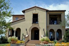 Mediterranean stucco with tile roof in Newman Village - Frisco Texas