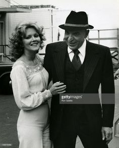 Actress Marge Hansen and actor Telly Savalas sighted on location filming Kojak on March 18, 1976 at Universal Studios in Universal City, California. CREDIT: RON GALELLA