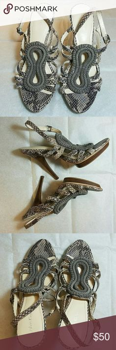 Calvin Klein Perla Python Sandal Perla Classic Python Platform Sandal in taupe. In amazing shape, worn only once to a wedding! Features a front platform for comfort. Calvin Klein Shoes Sandals