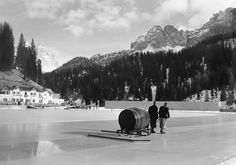 """Looking Back: [43] Photos From the First 12 Winter Olympics [1924 to 1976],"" from ""The Atlantic"" -- Click through for some fascinating photos! -- Shown: Precursor to the Zamboni! ""To form a fresh smooth surface, lukewarm water is poured over the ice of the speed skating rink of Lake Misurina, where the 1956 Winter Olympics speed skating events will take place in Cortina d'Ampezzo, Italy, on January 13, 1956."" (AP Photo)"