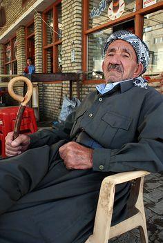 Elderly Kurdish man outside cafe in northern Iraq    Halabja, November 2009.
