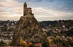 Saint-Michel d'Aiguilhe is a chapel in Aiguilhe, near Le Puy-en-Velay, France, built in 962 on a volcanic formation (Roca Saint-Michel) Ancient Buildings, Saint Michel, Romanesque, Pilgrimage, Monument Valley, Places To Go, Beautiful Places, Wonderful Places, Around The Worlds