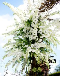 Beautiful white florals on this luxe Chuppah | A super luxe Jewish wedding at the Four Seasons in the UK | Smashing the Glass Jewish wedding blog