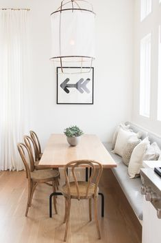 """Mixing textures is key in a largely monochromatic room. """"Materials such as stone, ceramic, and glass can all be white, but each has a different characteristic inherent to its materiality,"""" says Heininger. That interplay of different surfaces creates visual interest in a room."""
