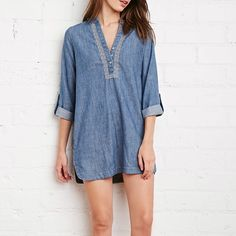 F21 Embroidered Denim Dress Never wore it! Has functional pockets. Unlined though. Would recommend wearing this with leggings and boots if you're tall unless you're confident enough to wear it on its own! Dress is darker in person. Great material. (100% cotton). Forever 21 Dresses