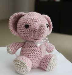 **Please note: This listing is for the pattern (in ENGLISH), NOT the actual doll!**  Meet Peanut, my version of a cute little baby elephant. His pastel spotted body gives him a unique and whimsical look. Depending on ribbon or yarn color, Peanut can be customized to be the perfect gift for a boy or a girl! His cute little smile will brighten up anyone's day!  When made with the recommended worsted weight yarn and a G hook, this little pachyderm sits independently and measures about 7.5''…