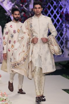 Featuring a beige printed sherwani based in matka silk with vine pattern embroidery. It comes with a set of printed kurta and churidaar in spun silk. Fabric: Matka silk, Spun silk Care Instructions: Dryclean only. Wedding Dresses Men Indian, Wedding Outfits For Groom, Wedding Dress Men, Bridal Outfits, Wedding Men, Indian Dresses, Groom Wedding Dress, Wedding Suits, Sherwani Groom