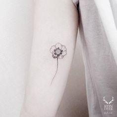 Inner arm tattoo of a poppy. Tattoo artist: Zihwa