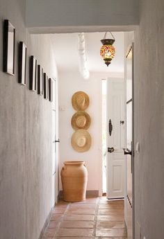 grew up in a house with saltillo tiles and white plaster walls