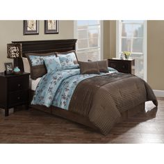 Create a relaxing retreat with bedding that is sumptuous and coordinated with this eight-piece comforter set. Featuring a contemporary, blue-and-brown color scheme, floral detailing, and clean, linear quilting, it has a rich and sophisticated look.