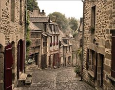 Rue du Jerzual in Dinan (Brittany, France) Dinan in northeastern Brittany is a wonderful and romantic medieval city. Medieval City, Medieval Times, Medieval Fantasy, The Places Youll Go, Places To See, San Francisco, Brittany France, Saint Martin, France Photos